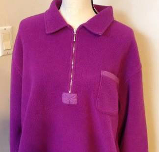 A magenta quarter-zip fleece pullover